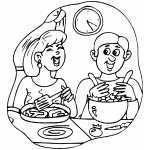 Couple Laughing And Cooking Dinner